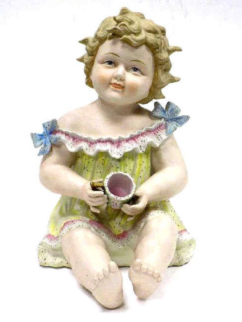 VICTORIAN PIANO BABY WITH CUP FIGURE