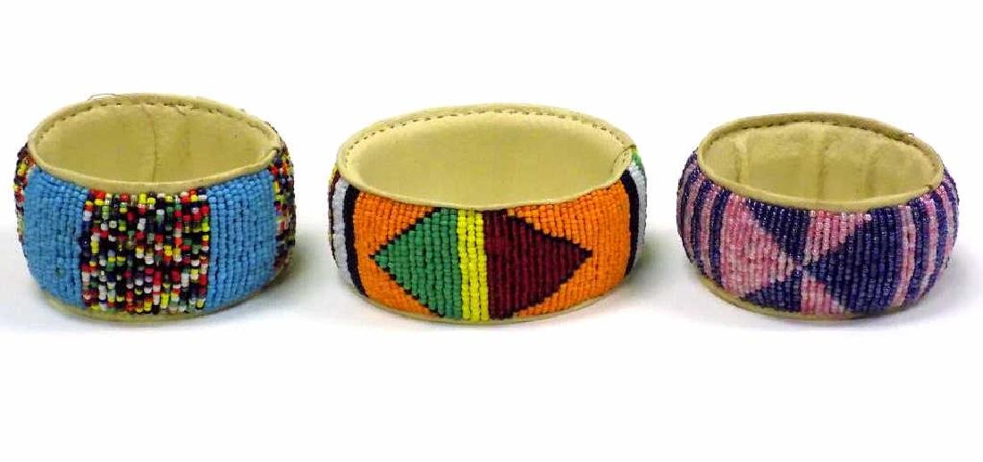 GROUP OF 3 ARTISAN MADE AFRICAN BANGLE BRACELETS