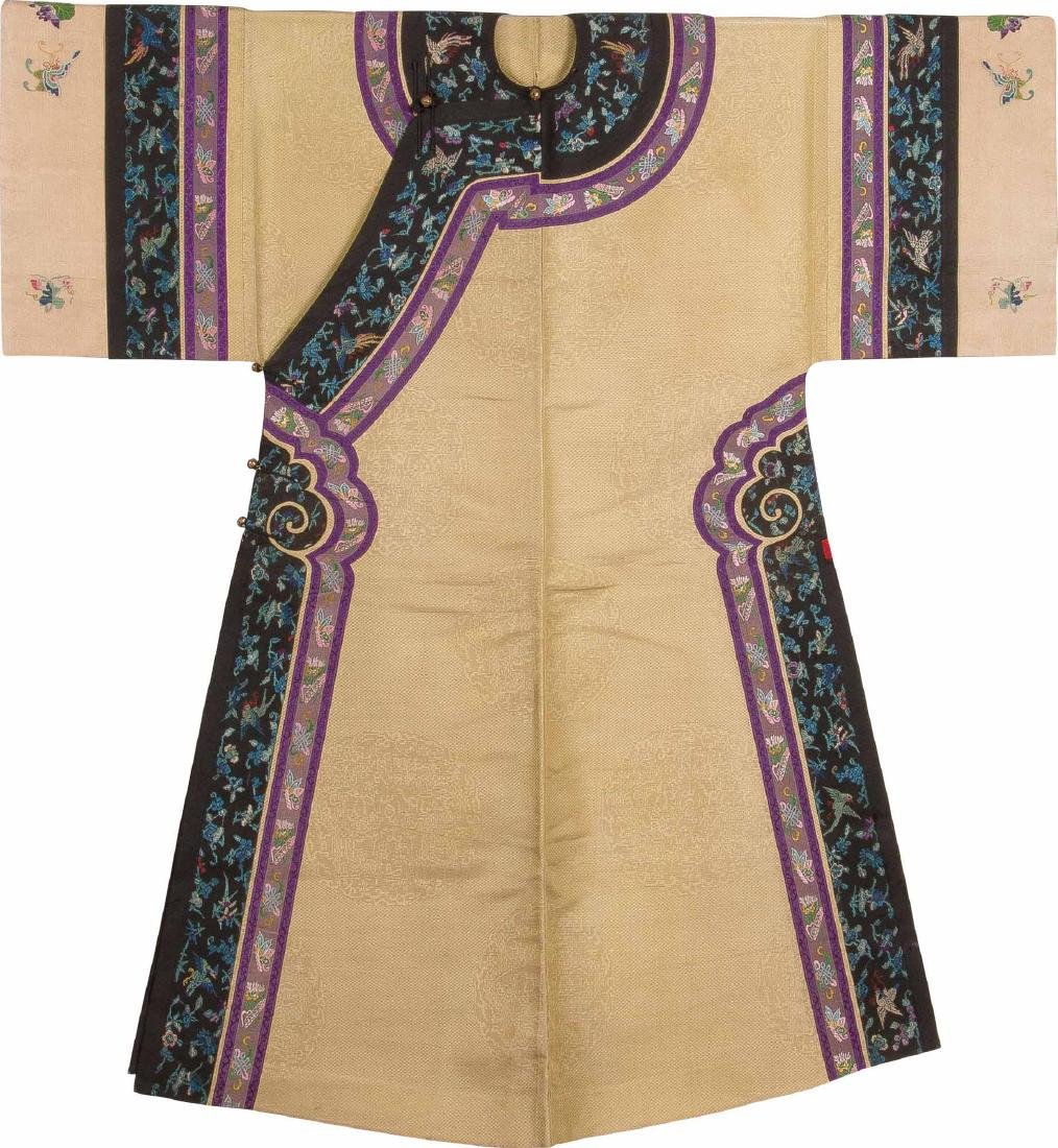 An Embroidered Silk Yellow-Ground Silk Dragon Woman's
