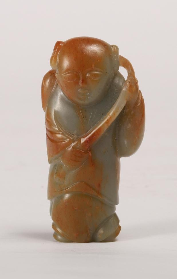 A CARVED WHITE JADE BOY HOLDING LOTUS, QING DYNASTY