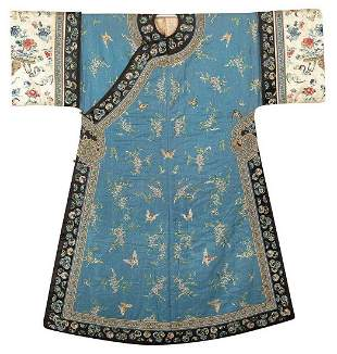AN EMBROIDERED SILK WOMAN'S COAT WITH BUTTERFLY