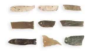 NINE PIECES OF ARCHAIC JADE FISH, WESTERN ZHOU PERIOD