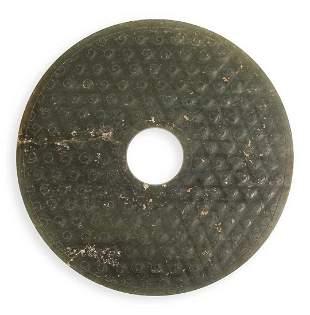 AN ARCHAIC GREEN JADE DISC, BI, HAN DYNASTY