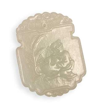 A CARVED WHITE JADE BOY PLAQUE, QING DYNASTY