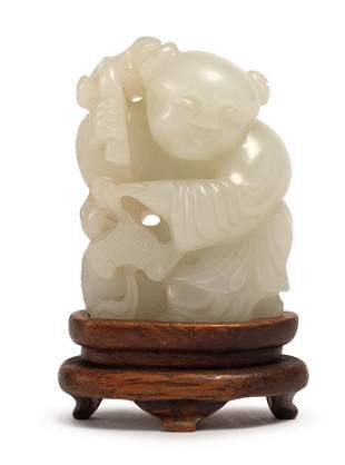 A CARVED WHITE JADE BOY, QING DYNASTY