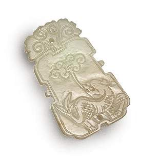 A CARVED WHITE JADE KYLIN PLAQUE, QING DYNASTY