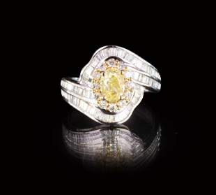 A 1 CT FANCY YELLOW GIA DIAMOND RING 18K GOLD