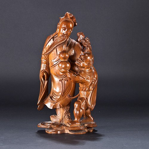 A HUANGYANG WOOD FIGURE OF LU DONG BIN