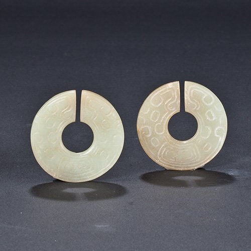 A PAIR OF WHITE JADE SLIT DISCS, JUE
