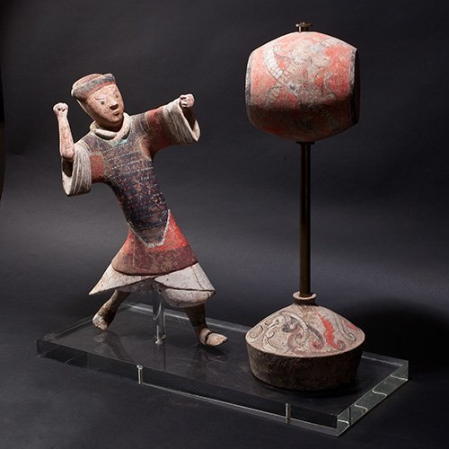 A COLORED TERRACOTTA FIGURE AND DRUM SET