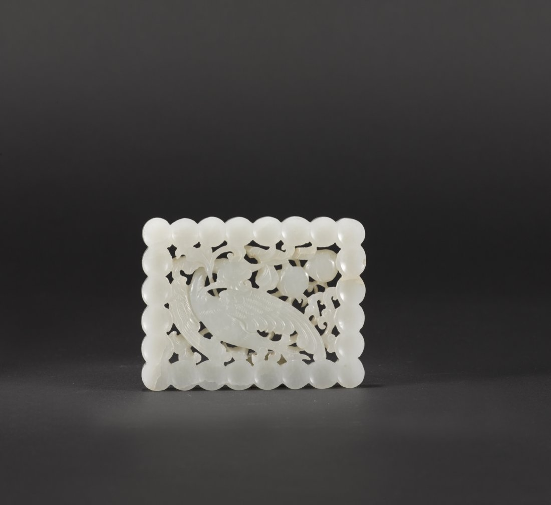 A CARVED WHITE JADE ORNAMENT