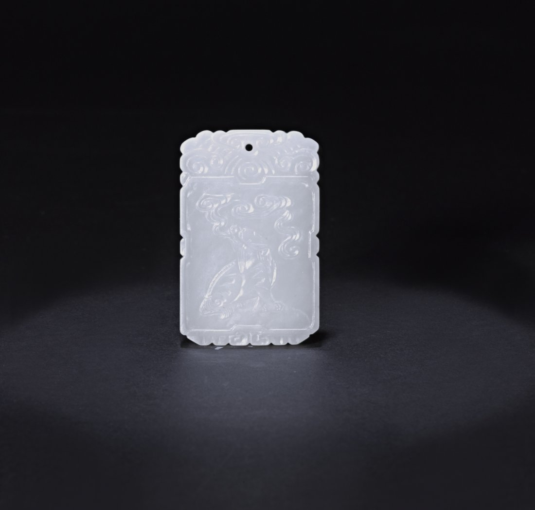 A FINE WHITE JADE PLAQUE