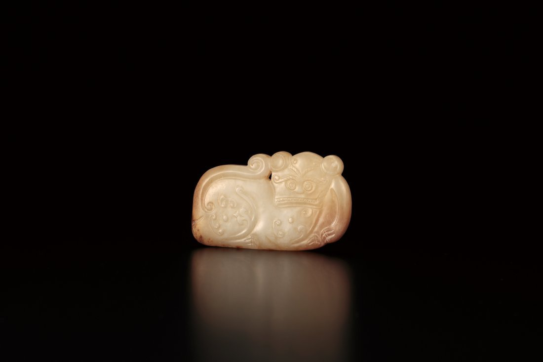 A CARVED WHITE JADE 'DRAGON AND TIGER' PENDANT