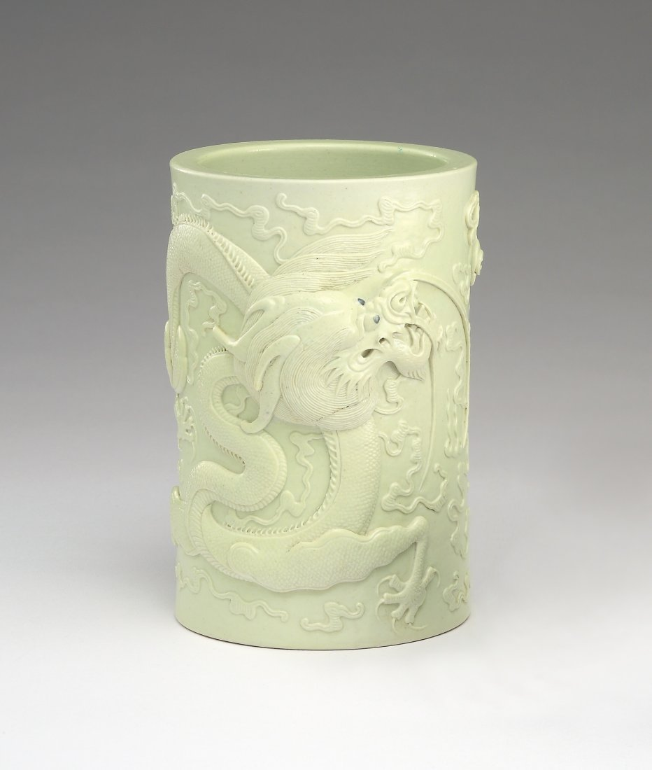 A Yellow-Glazed Carved 'Dragon' Brushpot
