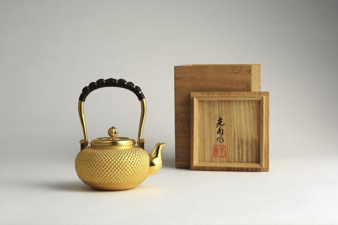 A Japanese Gold Tea Kettle By Ishiguro Konan