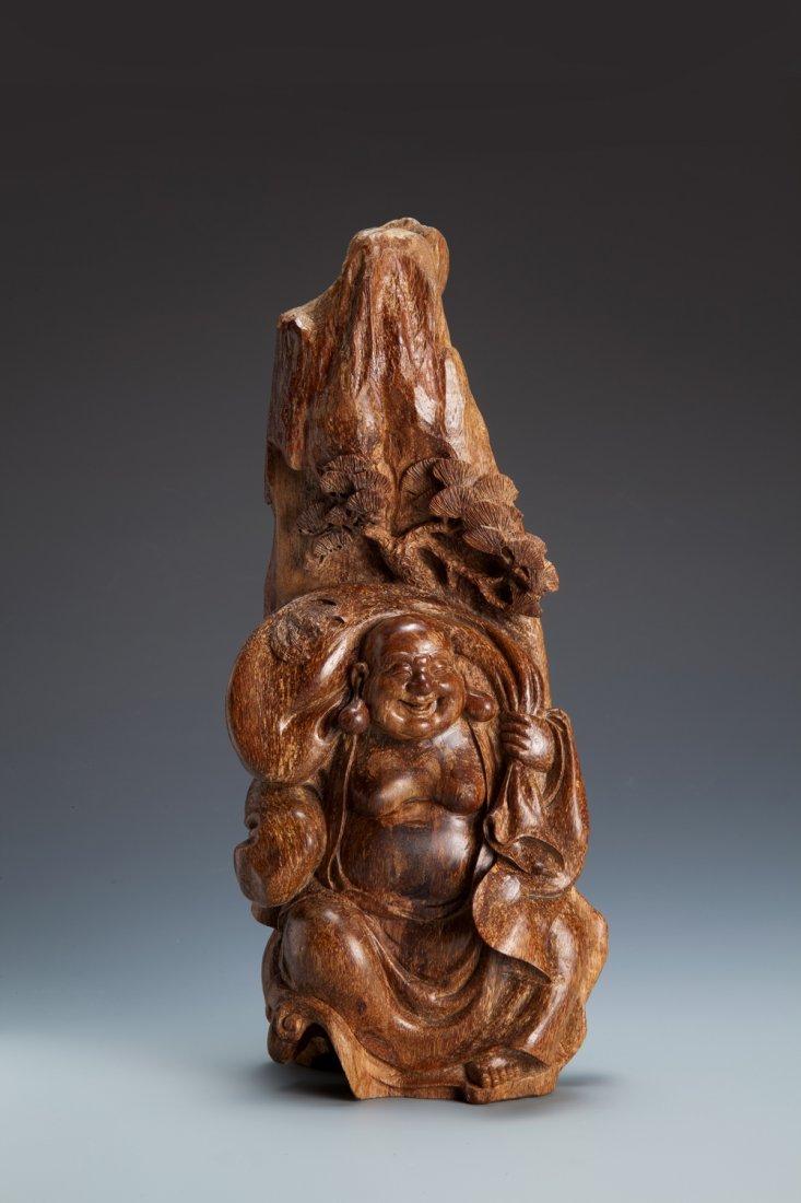 A Finely Carved Agarwood Mile Buddha Decotation