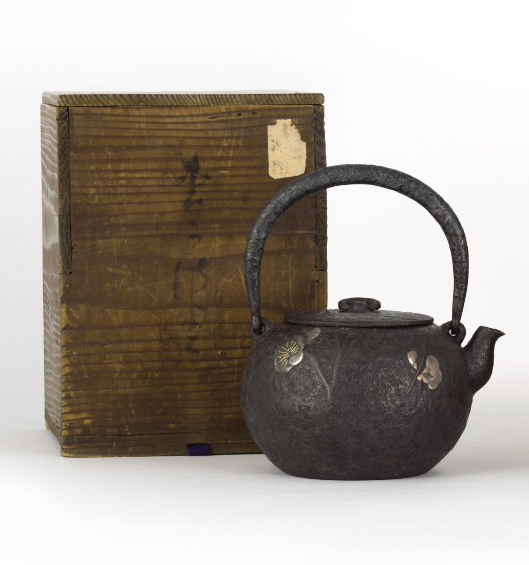 A Gold, Silver And Copper Inlaid Japanese Iron Tea