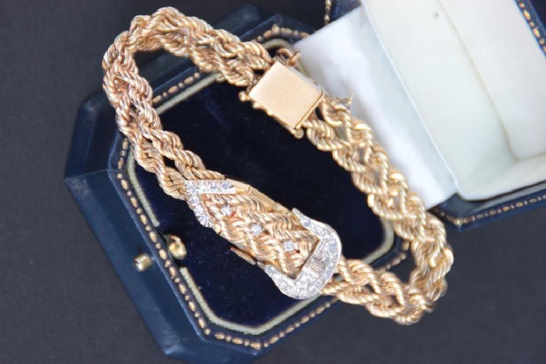 Bracelet montre pour dame en or jaune 14k , motif de