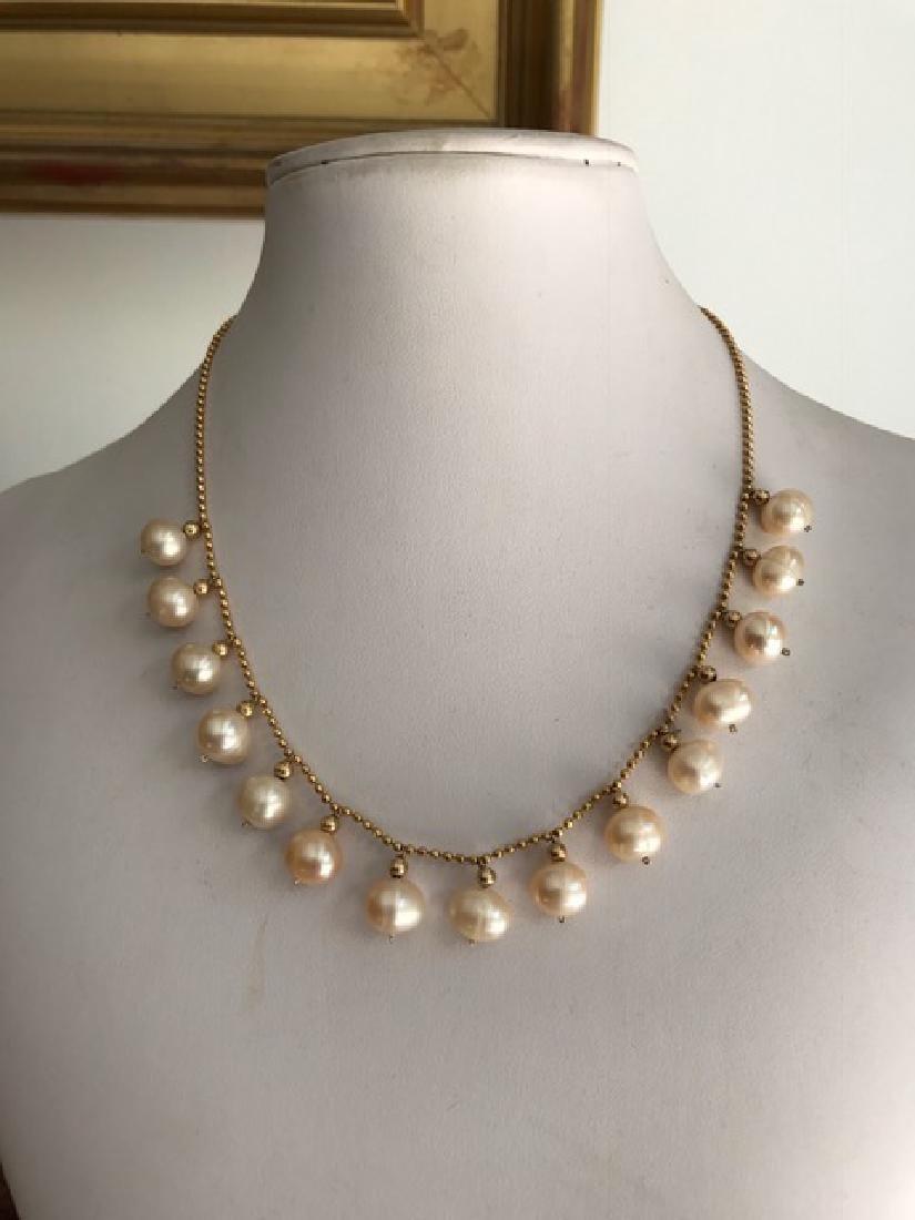 Collier en or jaune 18k orné de perles d'eau douce