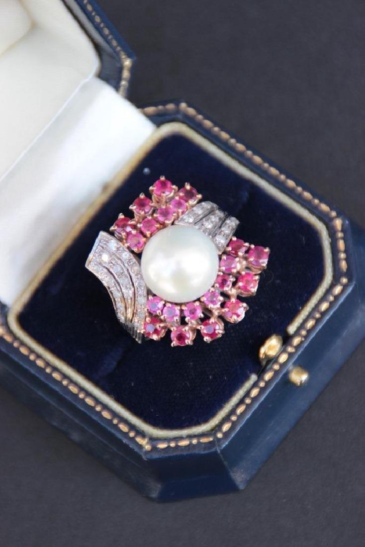 Bague en or blanc 9k ornée d'une importante perle
