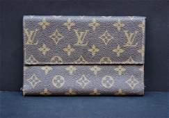 LOUIS VUITTON Portefeuille en toile enduite et cuir