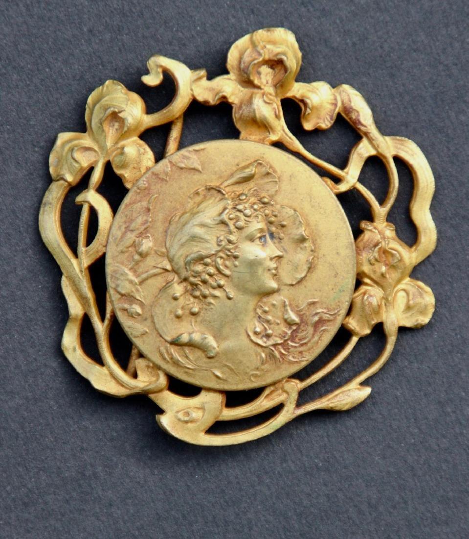Boucle de ceinture dans le goût art nouveau en bronze