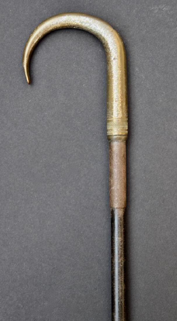 Une canne-fusil en métal  H : 85 cm
