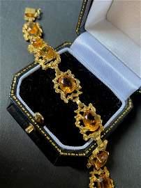 Bracelet en or jaune orné de pierres jaunes P :