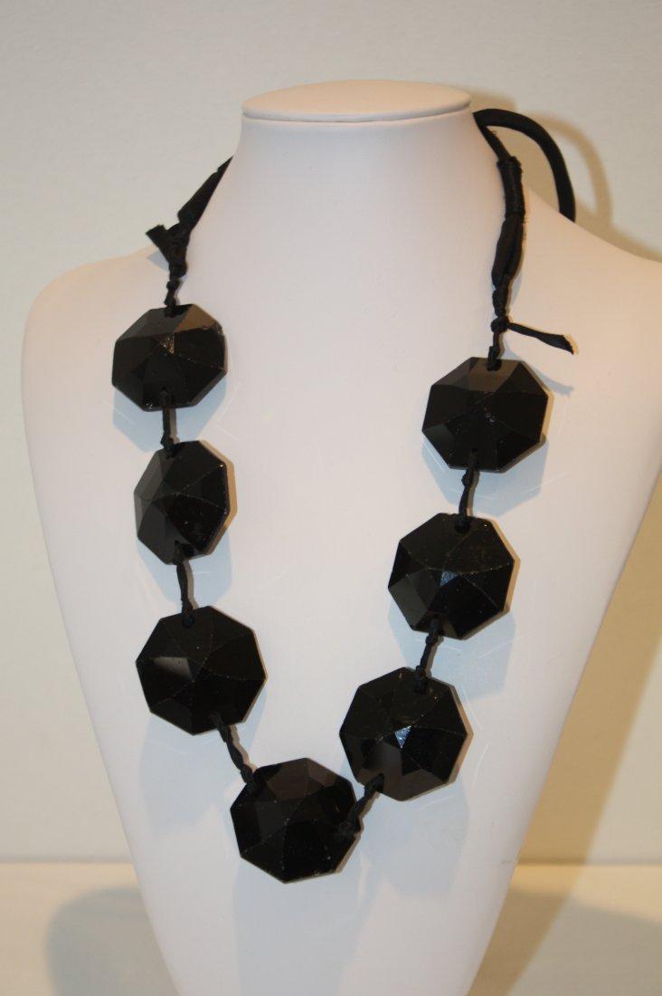 6: LANVIN - Collier formé  de perles octogonales en pât