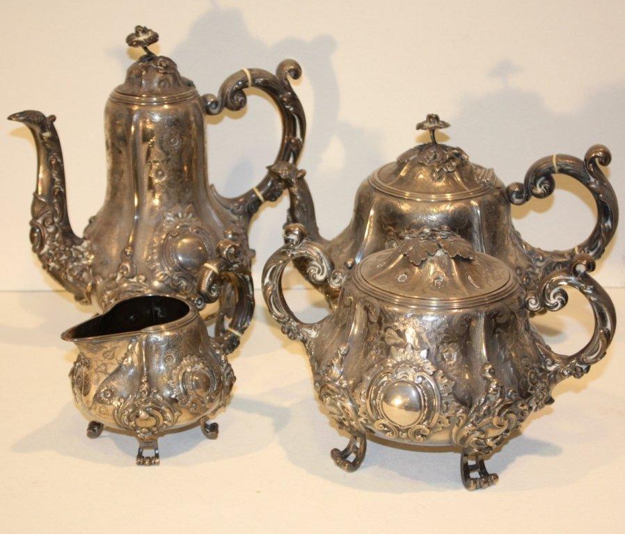 11: Service à thé et café en argent repoussé et ciselé