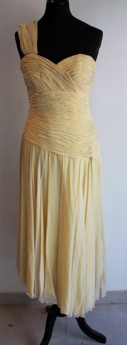 ANONYME Robe longue en crêpe de soie jaune, une seule b