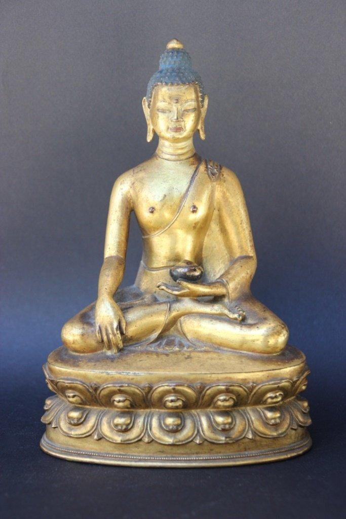 TIBET - XIXème - XXème siècle Buddha assis en bronze