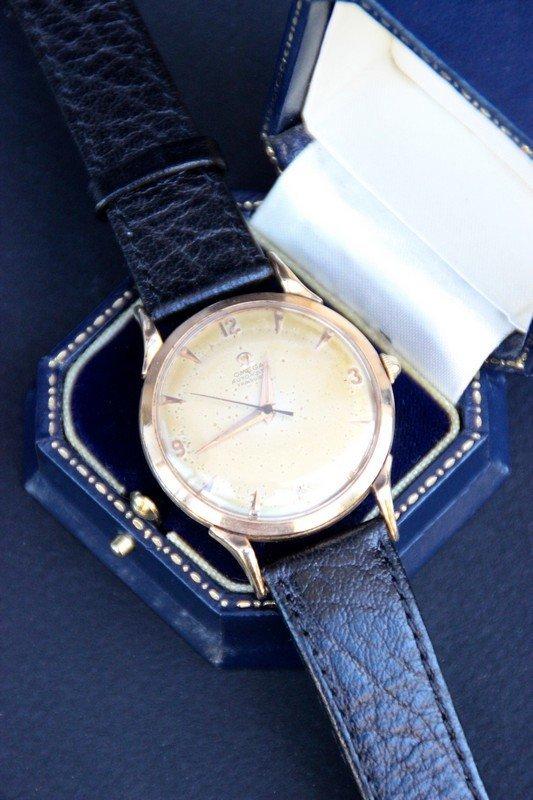 OMEGA Montre bracelet pour homme, à boitier en or jaune