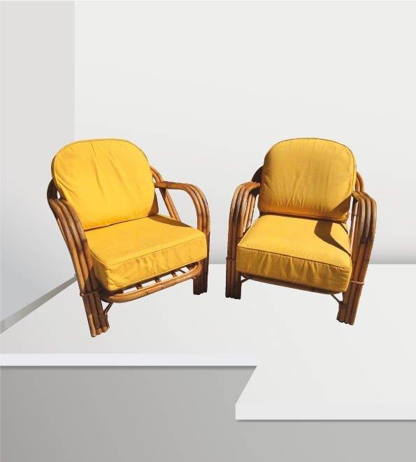 AUDOUX-MINET (XX) Paire de fauteuils en rotin à assise