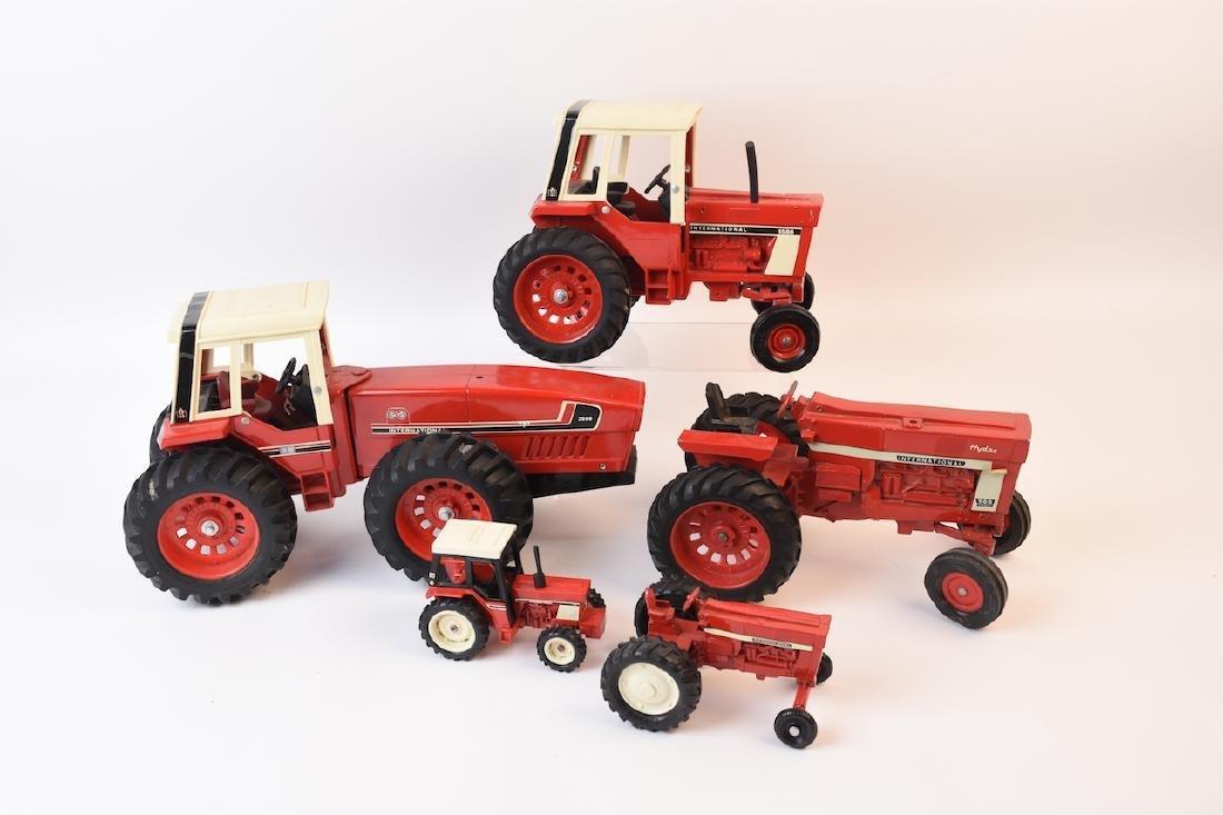 (5) International Harvester Die cast Tractors