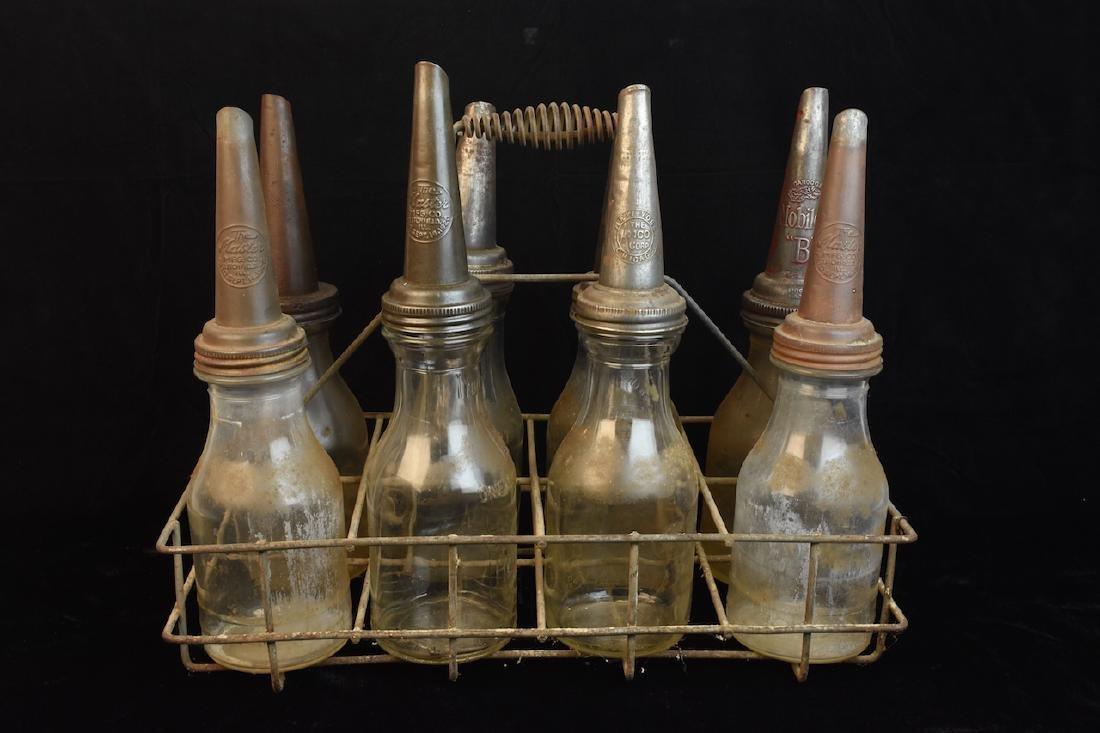 (8) Quart Oil Bottles w/ Funnel Adv. Tops & Carrier