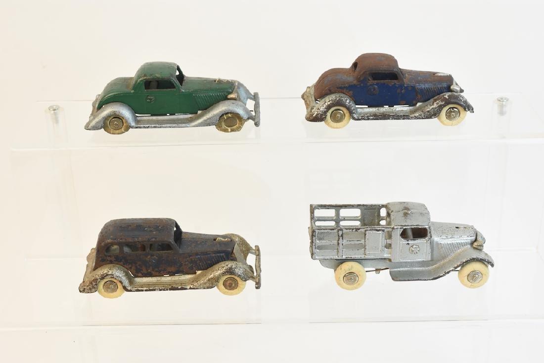 (4) Antique Cast Iron Die Cast Graham Toy Cars