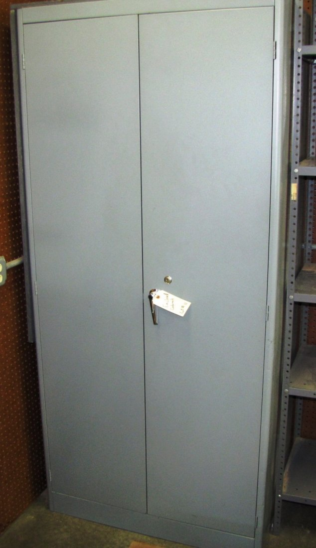11: Metal Enclosed supply cabinet with shelves