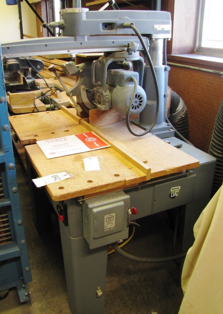 """22: 14"""" Rockwell Delta radial saw w/ roller extension"""