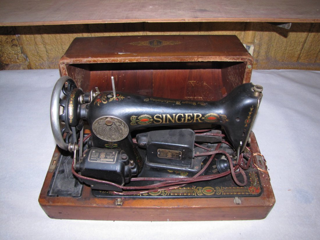 2: Antique Singer sewing machine with cover