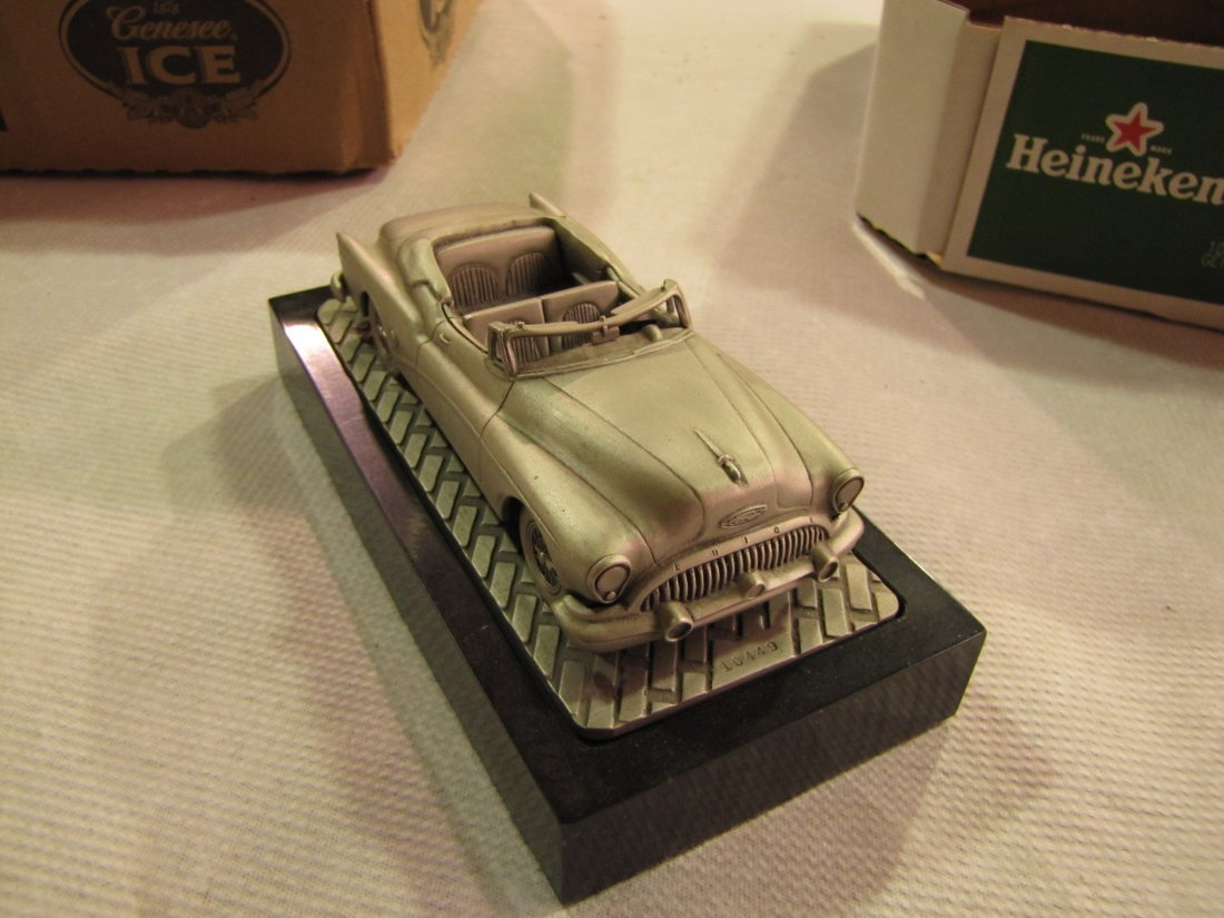 6: C. Rufo gray metal 1953 Buick model car with stand