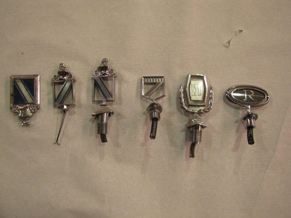 11: 6 hood ornaments