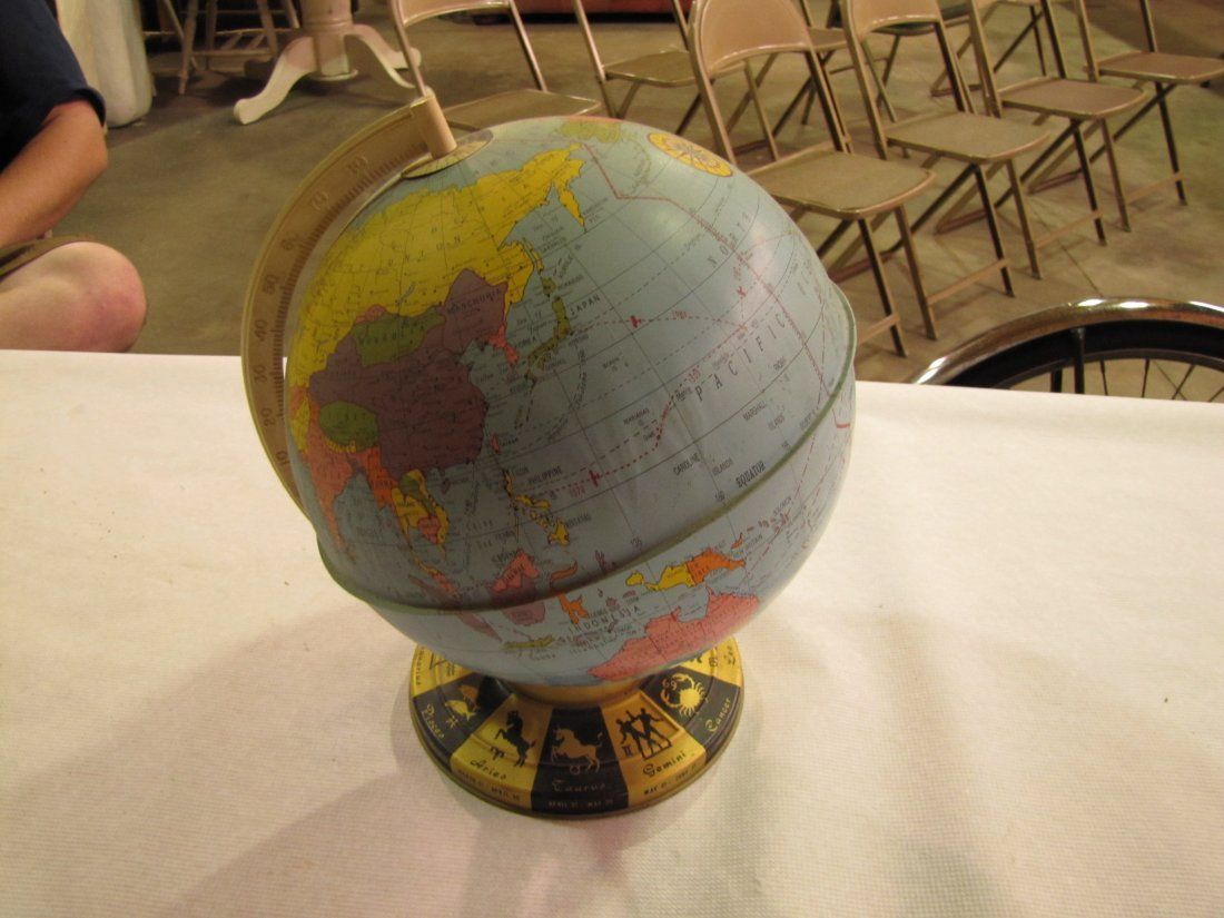 12: Ohio art spinning world tin globe