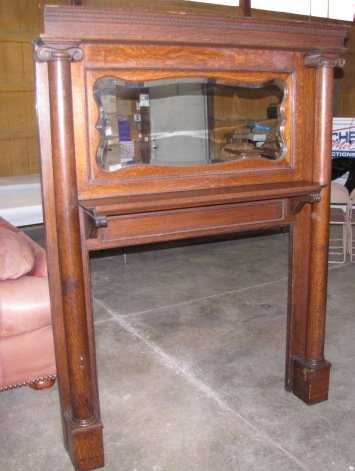 Lot: 38: Antique wood fireplace mantel with mirror