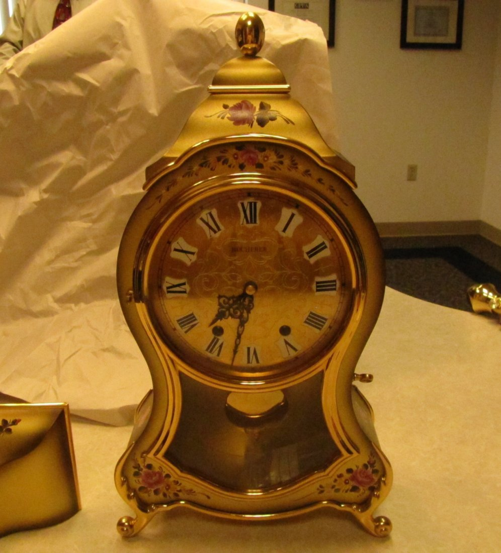 81Q: Hand painted Bucherer wall clock w/shelf