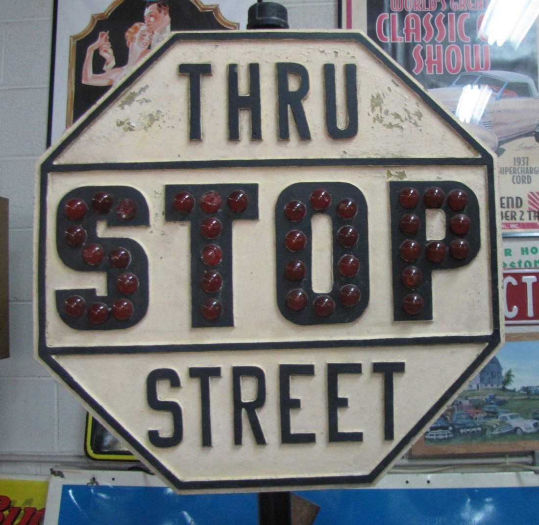3: Antique stop sign on pedestal with glass reflectors