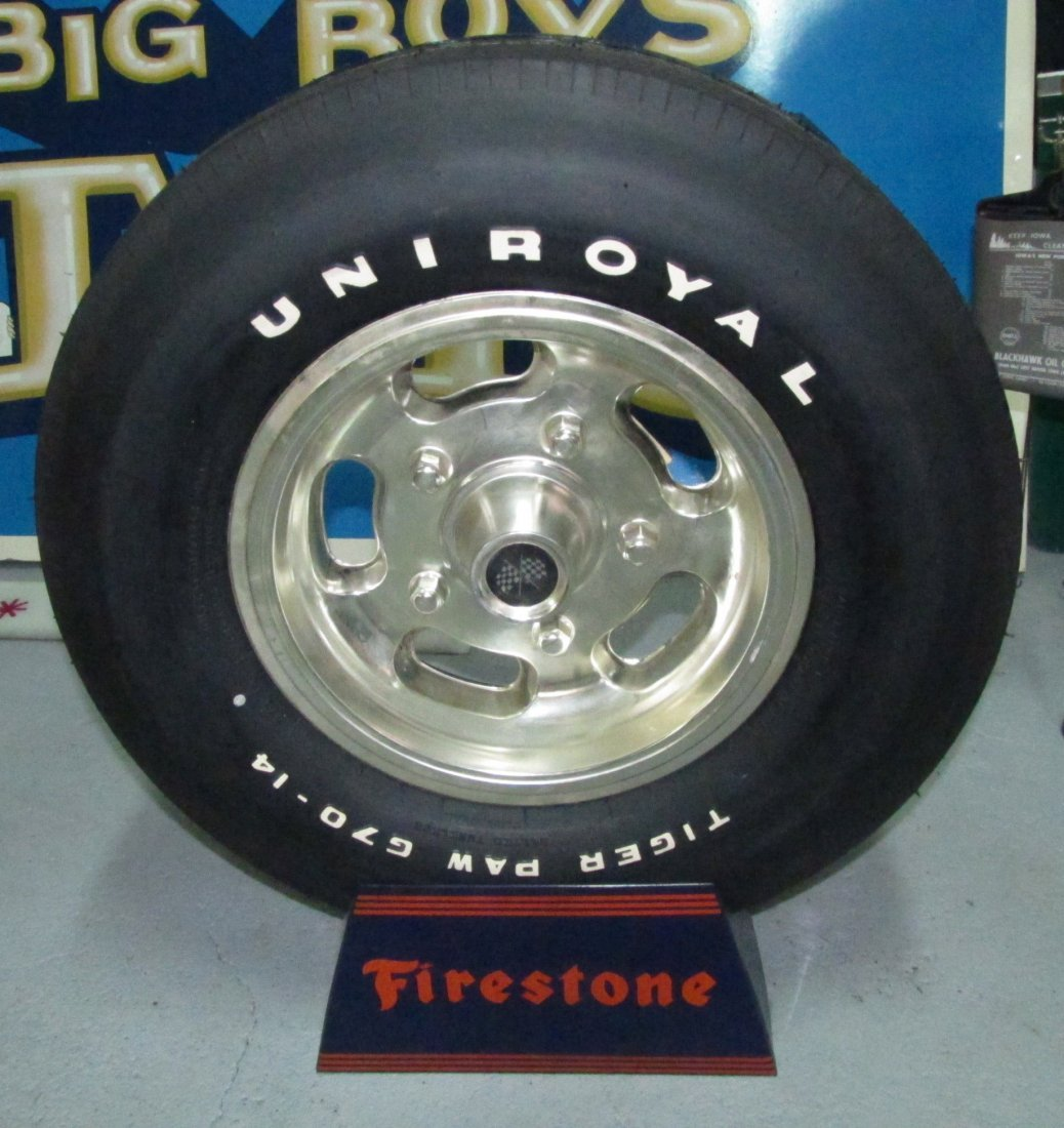 9: Tintype Firestone tire display