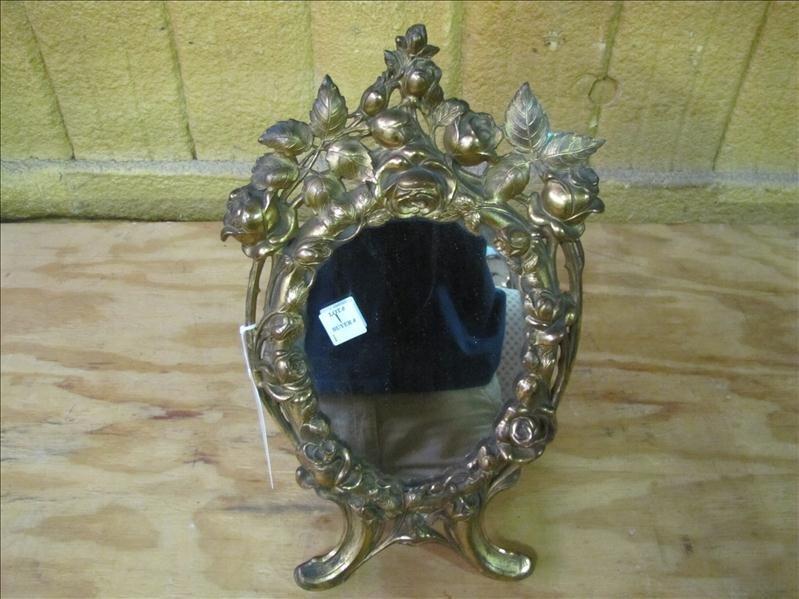 13: Gold framed mirror