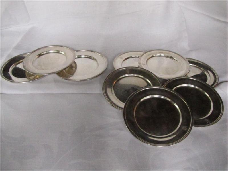 32: Set of 9 Sterling Silver Plates