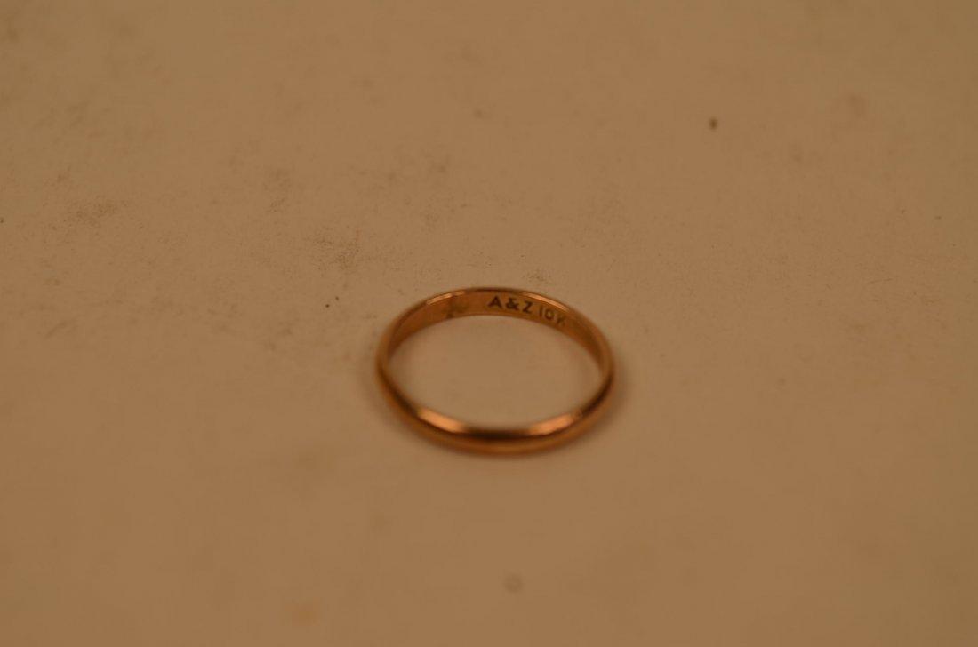 19: .7 Gram 10kt Gold Band Ring